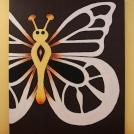 Motýl na dřevěné desce